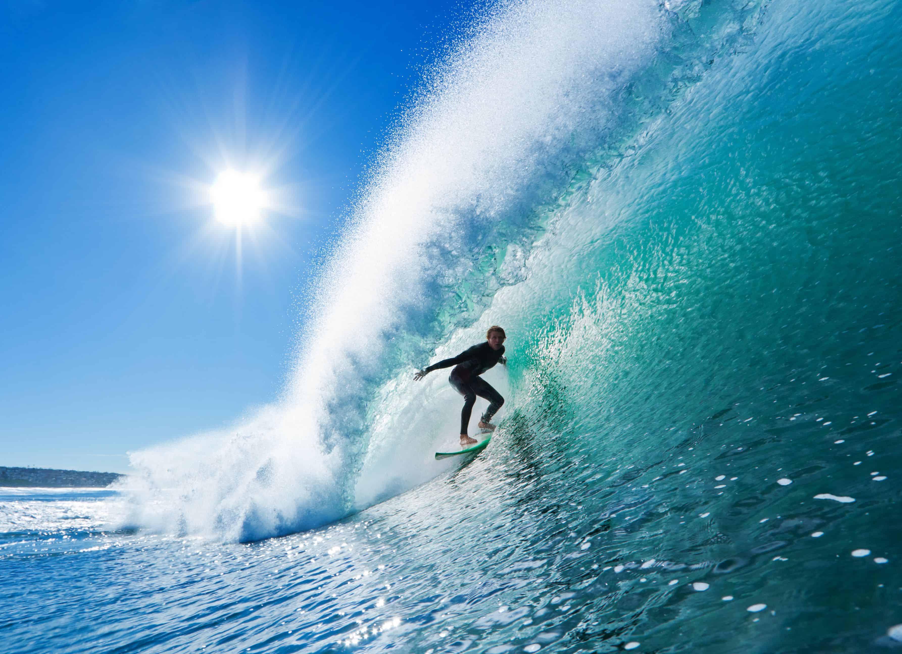 Surfer on Blue Ocean Wave in the Barrel