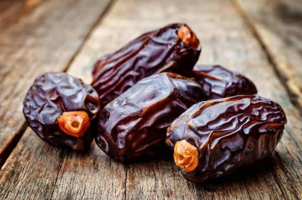 medjool dates on a dark wood background. toning. selective Focus