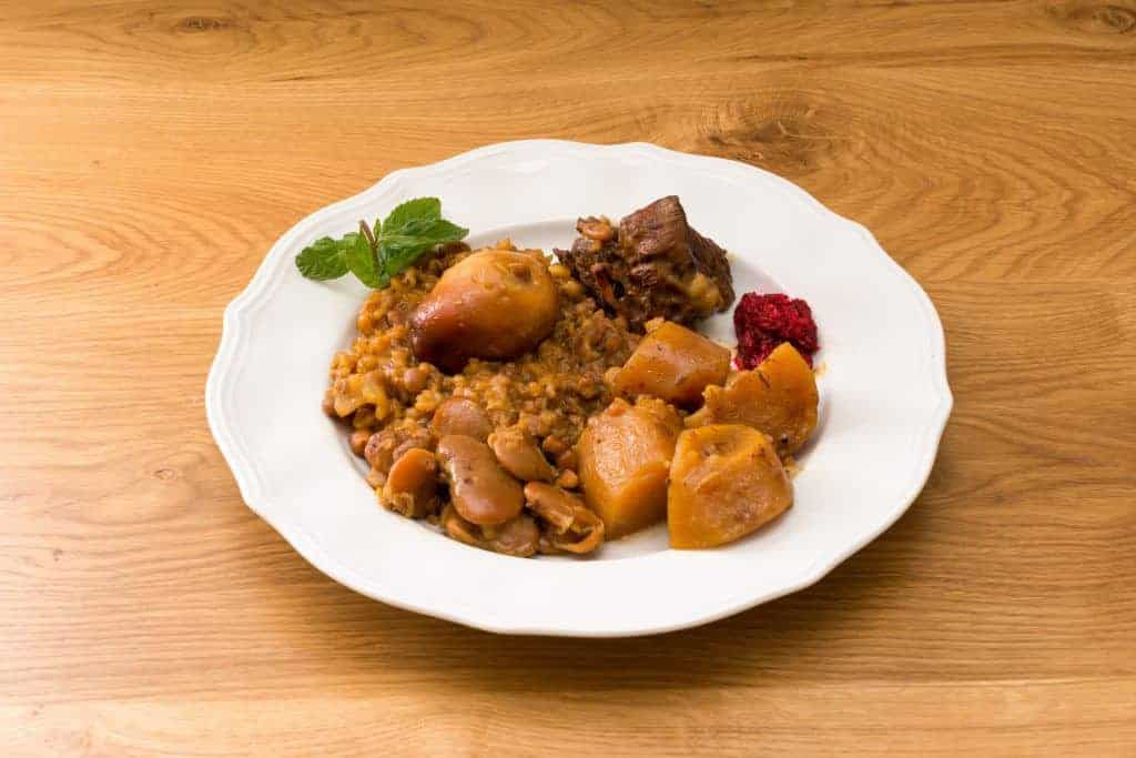 Traditional Jewish Cholent (Hamin) prepared is Israel as the main dish for the Shabbat meal made with beef, potato, beans, barley, and more and served with horseradish sauce (Chrein)