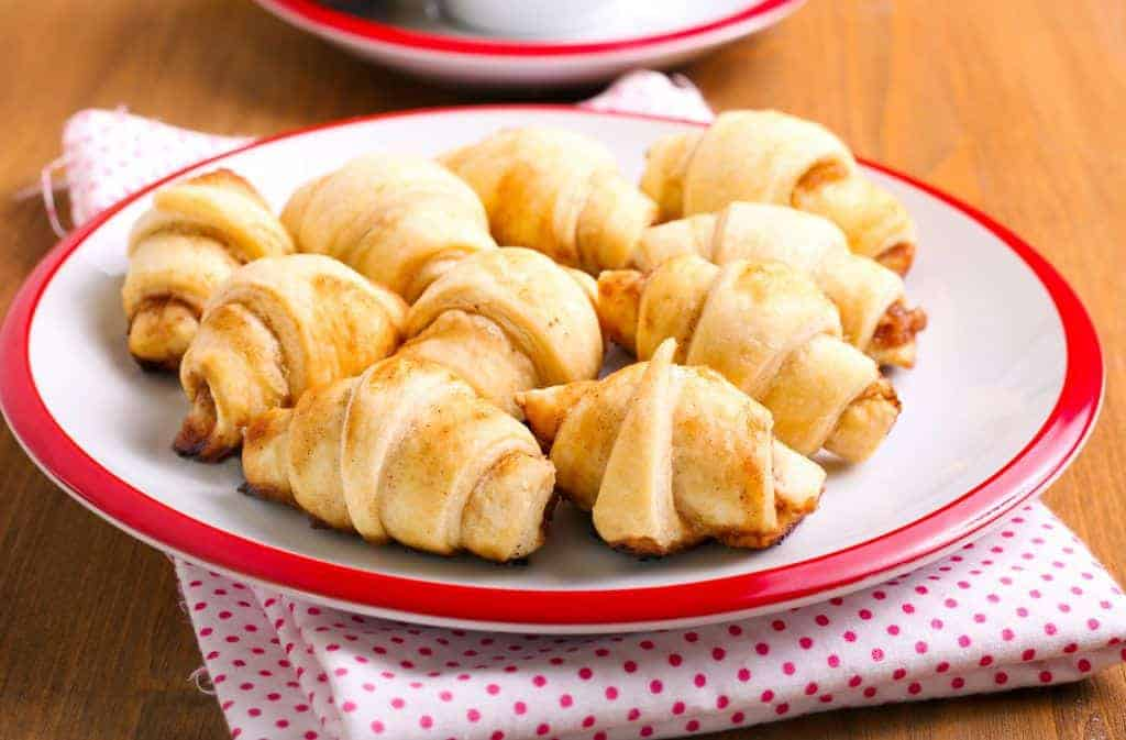 Cinnamon  and apple filling crescents on plate