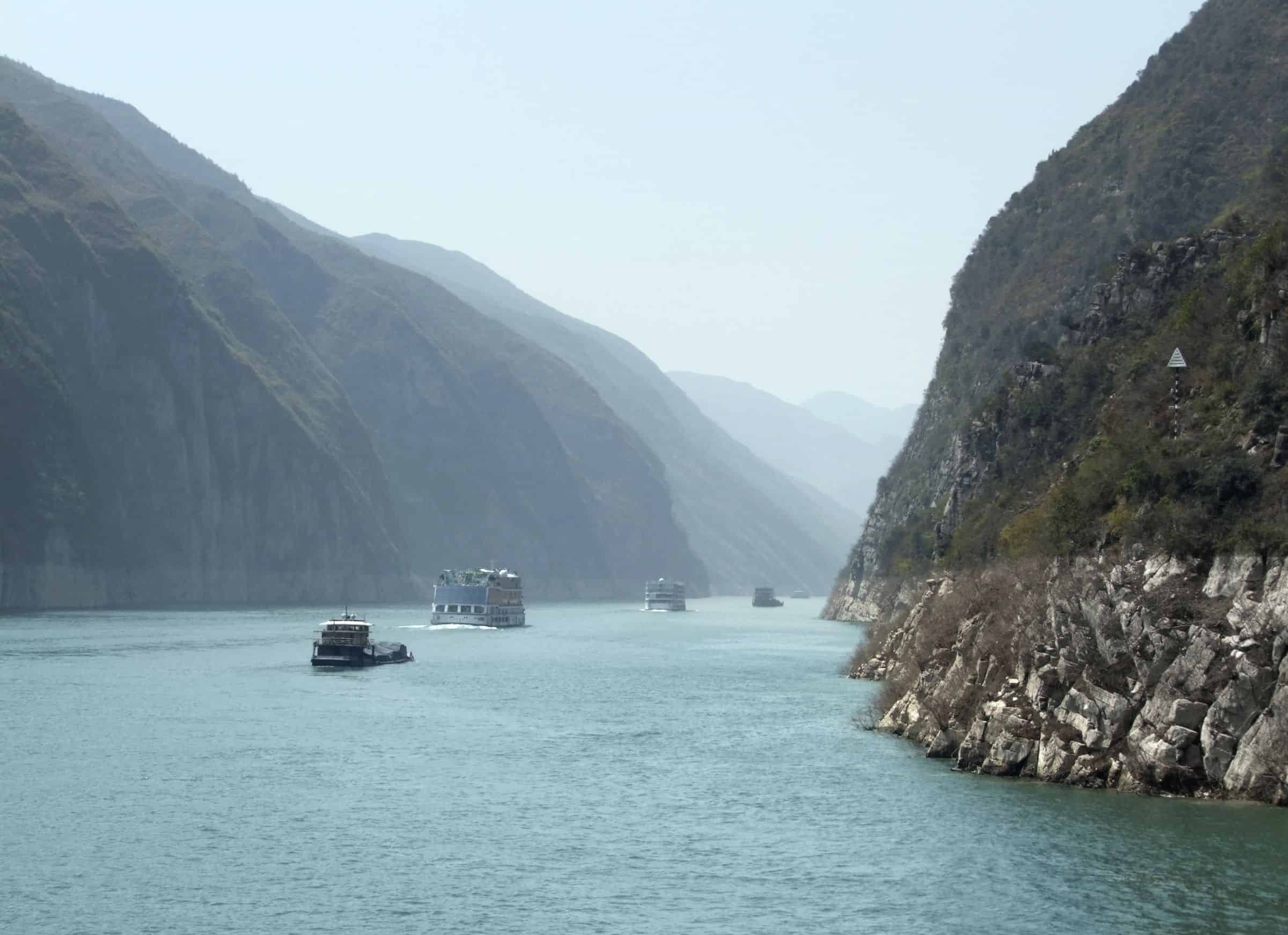 Foggy scenery along the Yangtze River in China including some ships and mountains