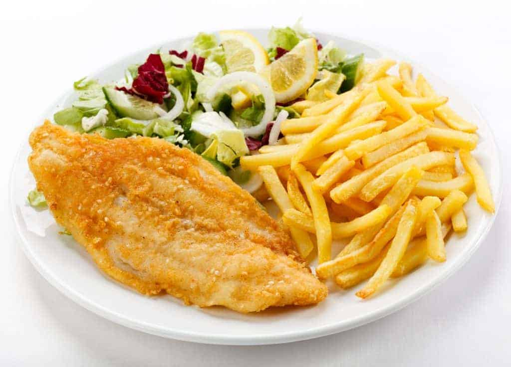 Fried fish fillet   Fish dish - fried fish with French fries and vegetables