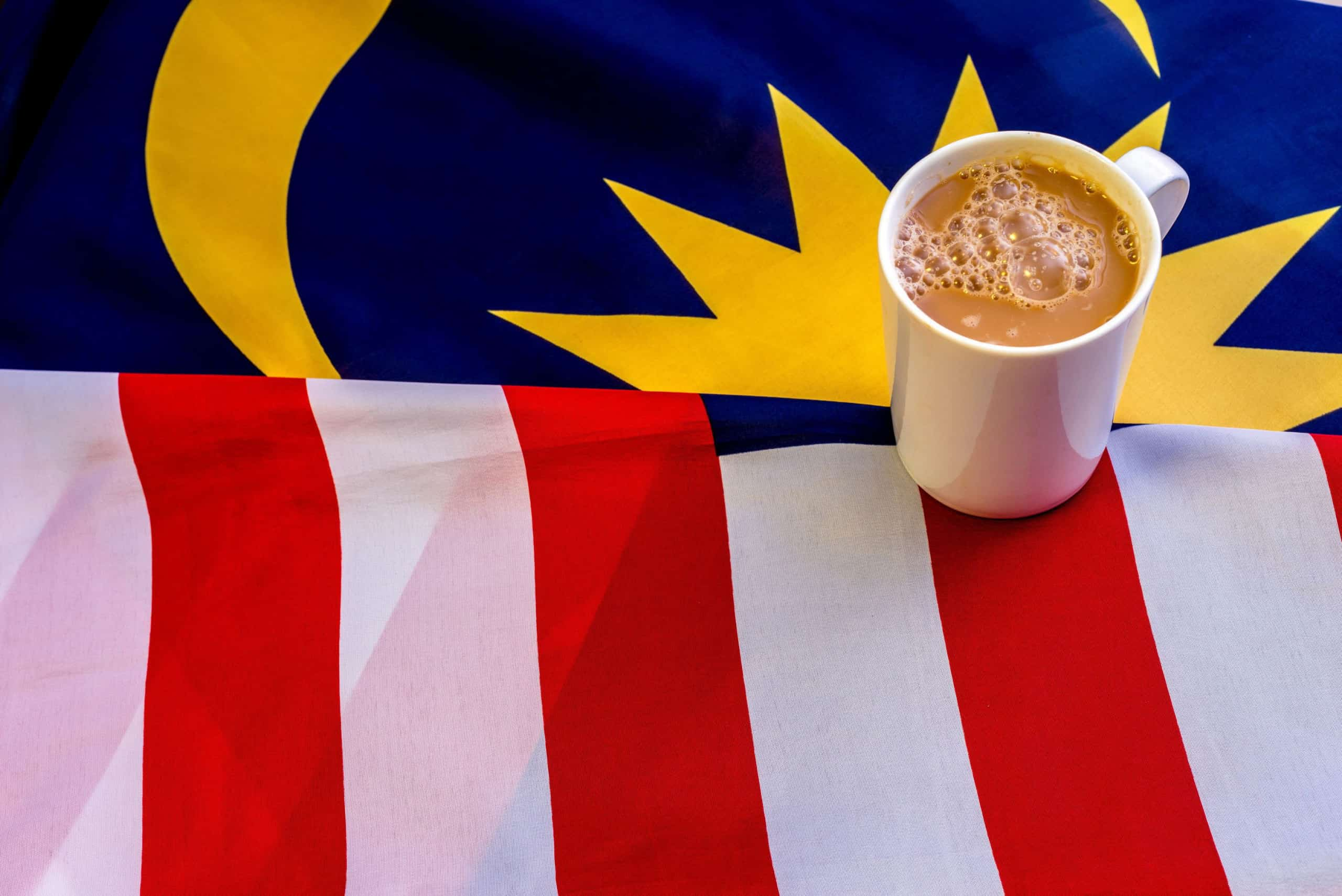 Malaysian Breakfast - Teh Tarik on Malaysia Flag. Teh Tarik is unofficially the national breakfast drink of Malaysia. It is a tea with milk