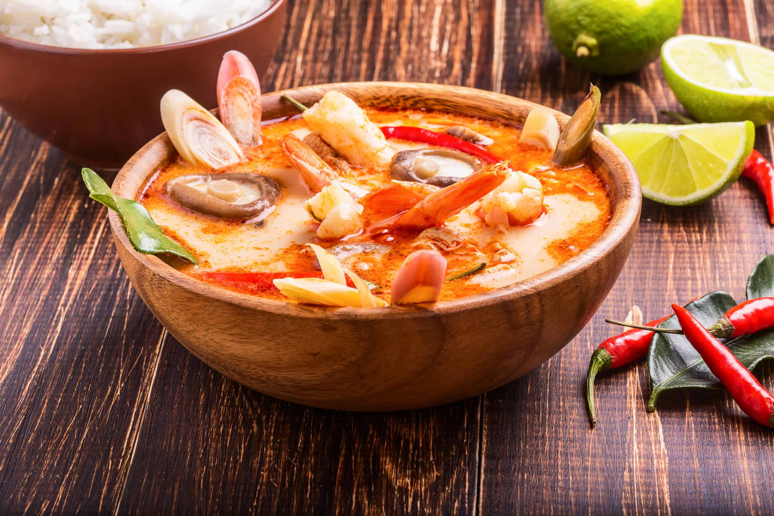 Thai Tom Yam soup with shrimp and shiitake mushrooms, served with lime and rice
