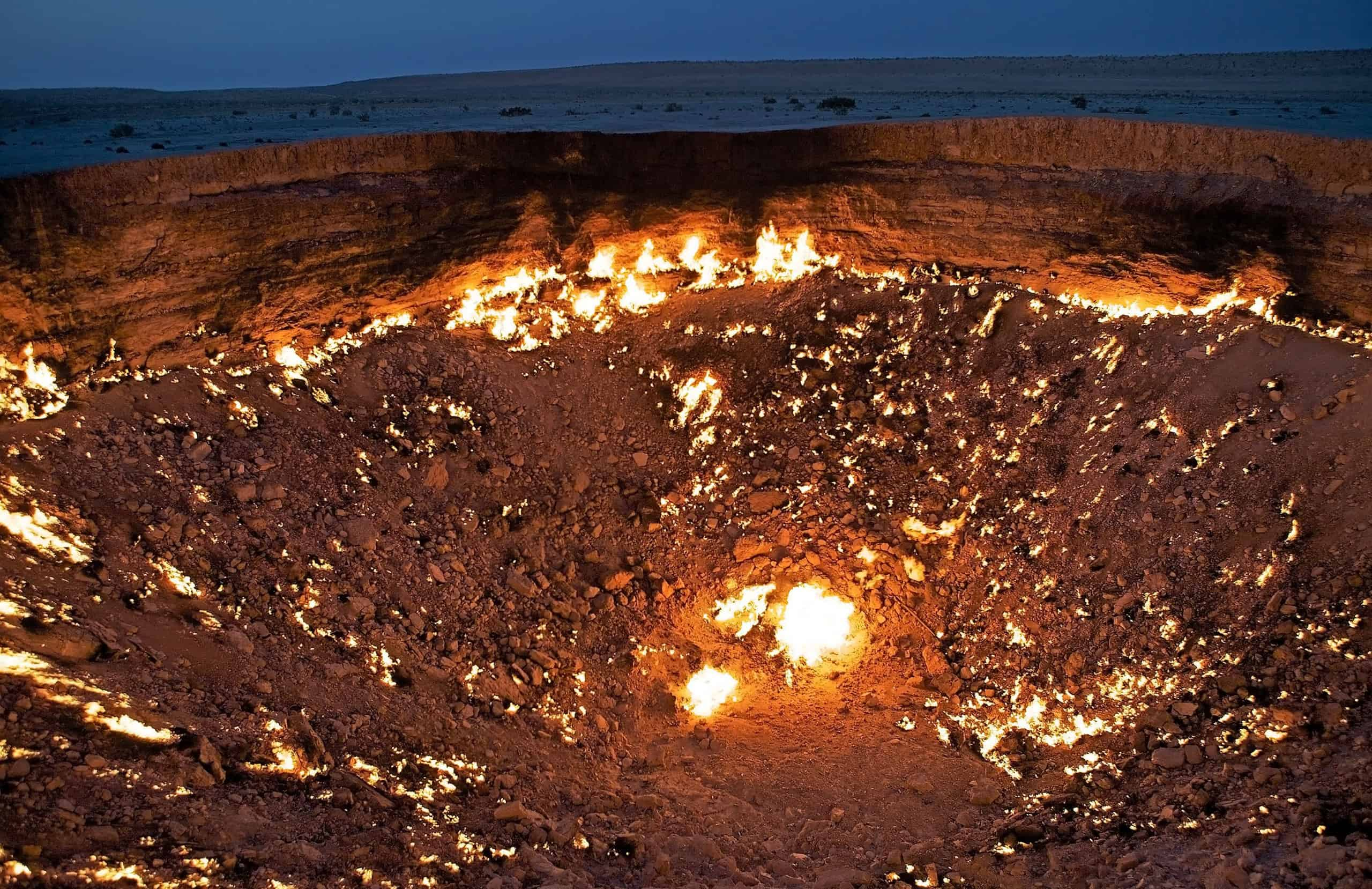 Door to Hell, Derweze, Turkmenistan. Door to Hell is a natural gas field in the Ahal Province. It is noted for its natural gas fire which has been burning continuously since it was lit by Soviet petrochemical engineers in 1971, in the middle of Karakum desert. Few foreigners have seen the crater and Tourism officials say the Door to Hell could developed into a key draw for adventure tourist. The site was identified in 1971. It was a oil field site. The engineers set up a drilling rig and camp nearby and started drilling operations. The ground beneath the drilling rig and camp collapsed into a wide crater and disappeared. No lives were lost in the incident.